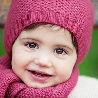 portrait of little girl wearing pink wooly hat children photography
